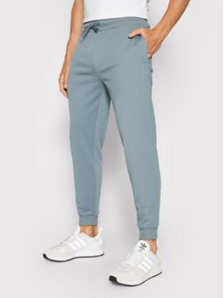 Guess Teplákové kalhoty U1GA19 JR06E Zelená Regular Fit pánské S